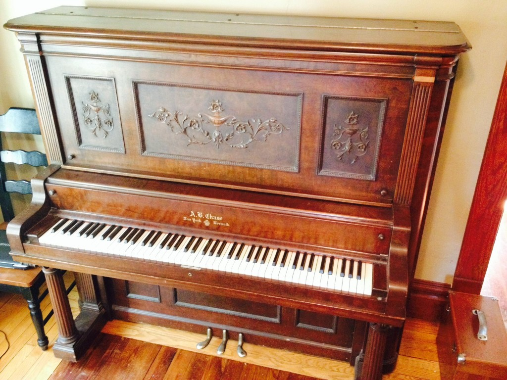 A 1903 A.B. Chase upright that I restored and sold in January 2014. My father's piano tuning tool kit (the wooden box) is in the right corner. This piano had a gorgeous sound as well especially after I installed new hammers.