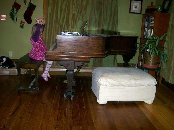 Zora, age five, at the 1913 AB Chase baby grand. Photo taken in 2009.