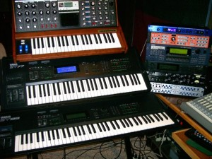 "My rig for the making of the album ""In Memorandom"" circa 2009. Moog Voyager on top of a Yamaha SY77 and SY99."